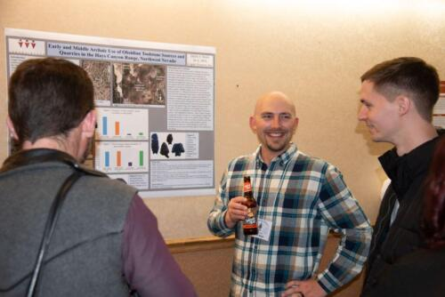 Three intrepid scholars study during the poster session