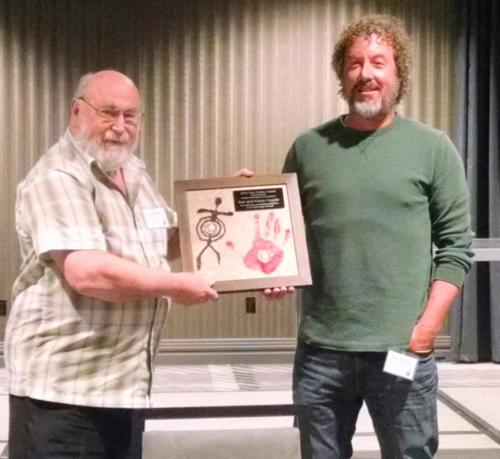 Ken Hopple accepting the Ting-Perkinds award for Karen and himself; photo by Christina Callisto